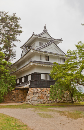 TOYOHASHI, JAPAN - MAY 31, 2017: Reconstructed Main Keep (donjon) of Yoshida Castle, Japan. Castle was founded in 1505 by Makino Kohaku, destroyed in a fire in 1873 and reconstructed in 1954