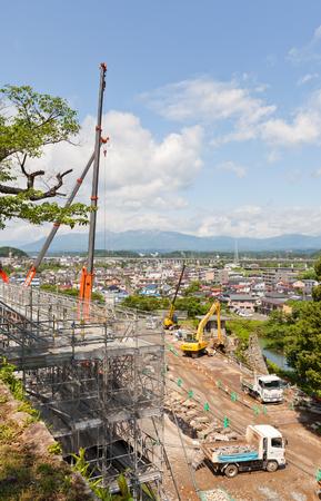 SHIRAKAWA, JAPAN – JUNE 2, 2017: Reconstruction works in Shirakawa (Komine) Castle, Japan. Castle walls were seriously damaged during Fukushima earthquake in 2011