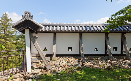 SHIRAKAWA, JAPAN – JUNE 2, 2017: Reconstructed earthen walls of Shirakawa (Komine) Castle, Japan. Castle was founded in 1340, rebuilt in 1627, destroyed in war of 1868 and reconstructed in 1991 Editorial