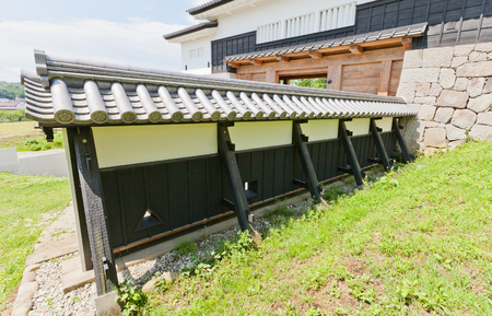 SHIRAKAWA, JAPAN – JUNE 2, 2017: Reconstructed wooden walls of Shirakawa (Komine) Castle, Japan. Castle was founded in 1340, rebuilt in 1627, destroyed in war of 1868 and reconstructed in 1991