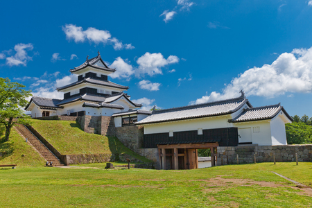 SHIRAKAWA, JAPAN – JUNE 2, 2017: Reconstructed Donjon and Main Gate of Shirakawa (Komine) Castle, Japan. Castle was founded in 1340, rebuilt in 1627, destroyed in war of 1868 and reconstructed in 1991