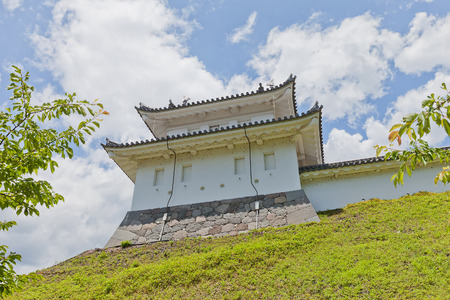 UTSUNOMIYA, JAPAN - JUNE 2, 2017: Reconstructed Fujimi Turret of Utsunomiya Castle, Japan. Castle was founded in 1062, destroyed in Boshin War of 1868 and reconstructed in 2007