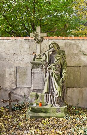 PRAGUE, CZECH REPUBLIC - NOVEMBER 4, 2017: Tomb of Emil Rebicek (1840-1860) and his relatives on Olsany Cemetery in Prague. Statue of an angel made by sculptor Karl Moldner