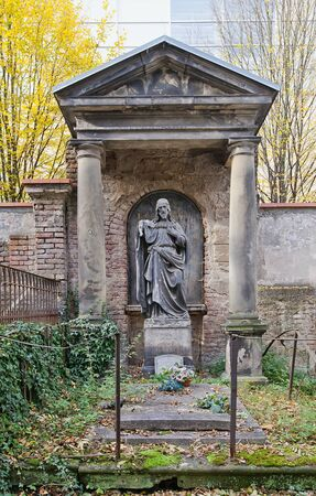 PRAGUE, CZECH REPUBLIC - NOVEMBER 4, 2017: Tomb of Catherina Bachheibl (1764-1856) and his relatives on Olsany Cemetery in Prague. Statue of Christ made by sculptor Josef Max