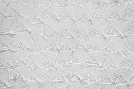 cement glossed like shell on white wall for background and pattern photo