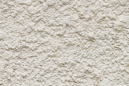 It is Rugged white cement and concrete wall for pattern and background. photo