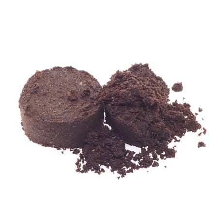 coffee grounds: It is Coffee grounds isolated on white.