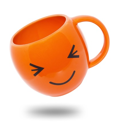 It is Orange mug with shadow isolated on white. photo