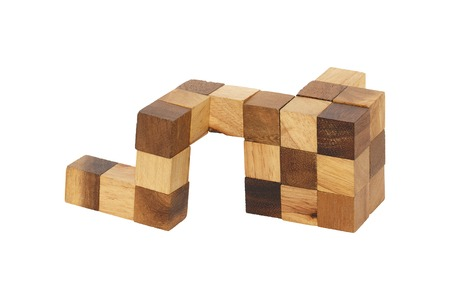 jig: It is Puzzle Wooden cube isolated on white.