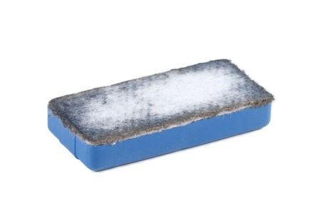 white chalk: It is Used blue eraser isolated on white.