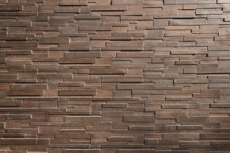 exterior wall: It is Dark  brown brick wall for pattern.