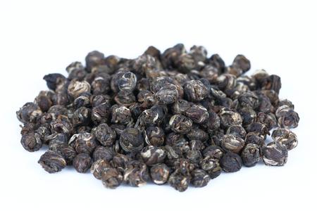 pearl tea: It is Dry Jasmine pearl tea isolated on white.