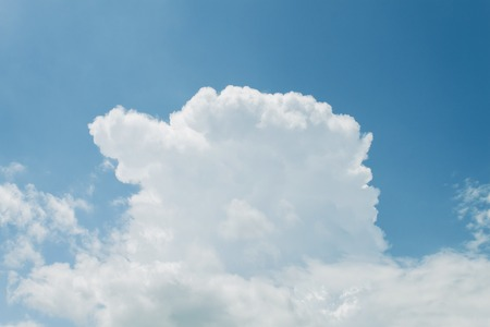 emit: It is White cloud on the blue sky. Stock Photo