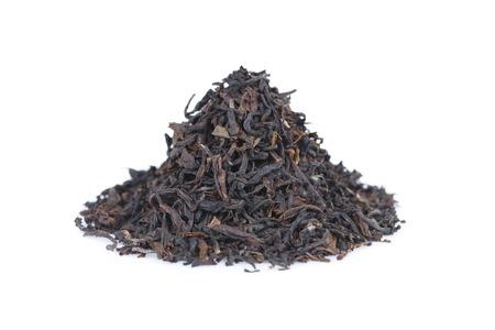 assam tea: It is Pile of black tea isolated on white. Stock Photo