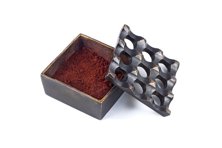 coffee grounds: It is Brass ashtray with coffee grounds for protection bad smell inside isolated on white.
