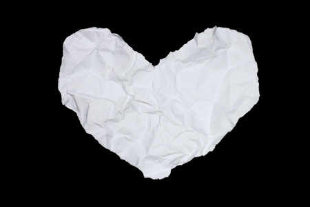 page design: It is Wrinkled white paper heart isolated on white.