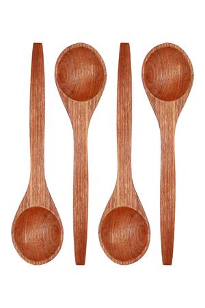 cuchara: Se trata de cuatro cucharas de madera aisladas en blanco. Foto de archivo
