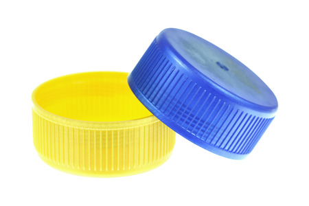 lids: It is Two plastic lids isolated on white.