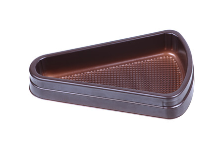 mould: It is Triangle plastic cake mould isolated on white.