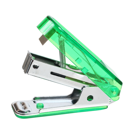 candid: it is green stapler isolated on white. Stock Photo