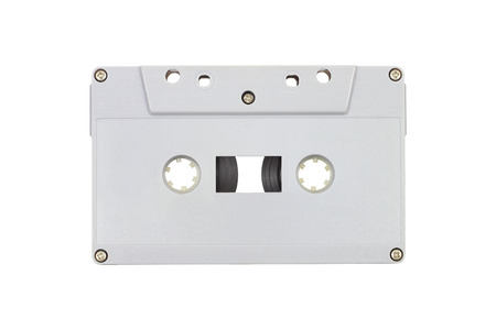audio cassette: it is grey plastic audio cassette isolated on white.