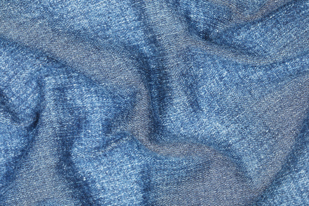 jeans texture: it is wavy on jeans texture for pattern and background. Stock Photo