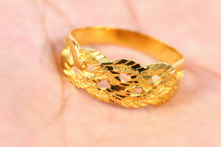 valued: it is one golden ring on hand. Stock Photo