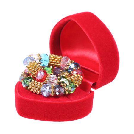 jewelry box: it is red heart shaped jewelry box with jewelry isolated on white.