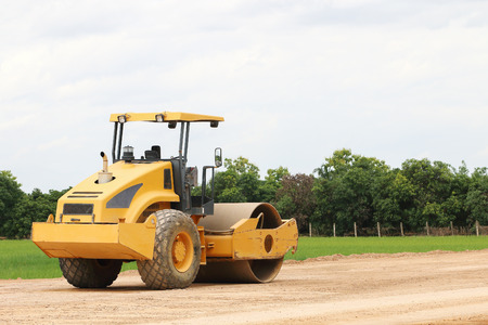 it is working road roller on ground.