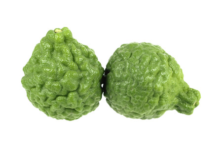 wrinkled rind: it is green kaffir lime isolated on white. Stock Photo