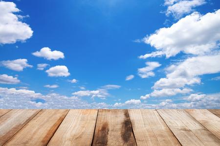 it is sky with wooden floor.
