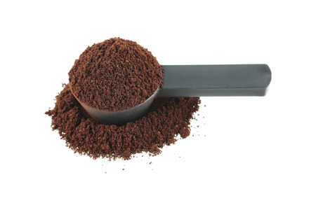 measuring cup: it is measuring coffee spoon with coffee powder isolated on white. Stock Photo
