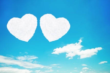 it is two heart shaped clouds on blue sky.