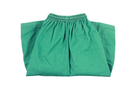 short pants: it is green folding short pants isolated on white. Stock Photo