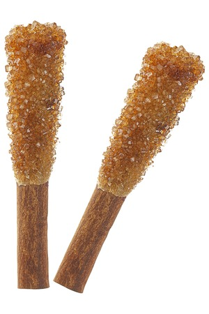 stirrer: it is two rock sugar sticks with cinnamon for coffee isolated on white. Stock Photo