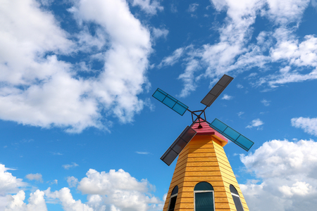 waterwheel: it is colorful windmill with blue sky background. Stock Photo