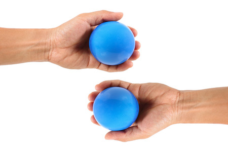 stress ball: it is two hands hold stress ball isolated on white.