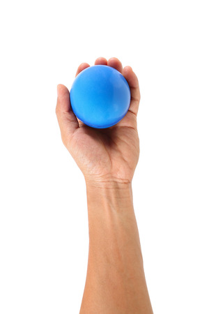 ball isolated: it is one hand holds stress ball isolated on white.