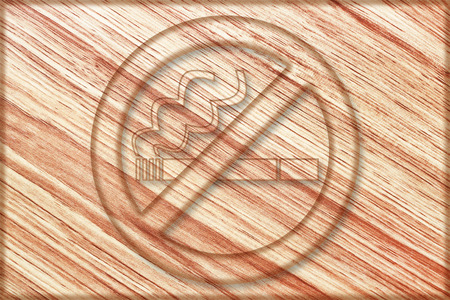 it is no smoking sign on wooden board. Stock Photo