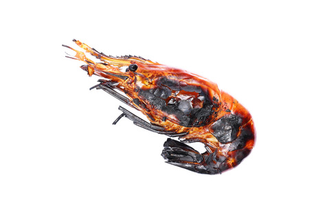 burned out: it is one char grilled giant freshwater prawn isolated on white. Stock Photo