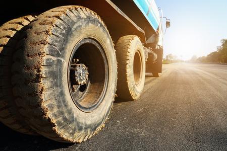 it is constructional truck on asphalt road.