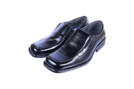 moccasin: it is gentlemen luxury black leather shoes isolated on white. Stock Photo