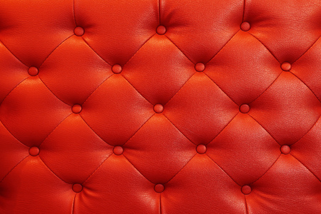 buttoned: it is elegant red leather texture with buttons for background and design.