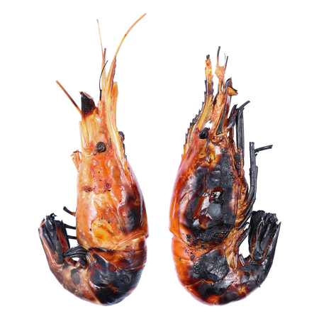 burned out: it is two char grilled big prawns isolated on white. Stock Photo