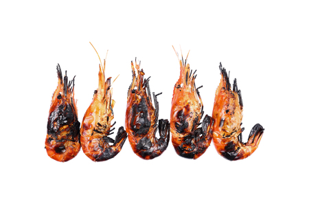 burned out: it is five grilled prawns isolated on white.