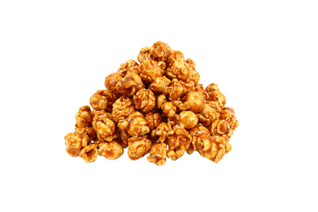 it is sweet caramel popcorn isolated on white. Imagens