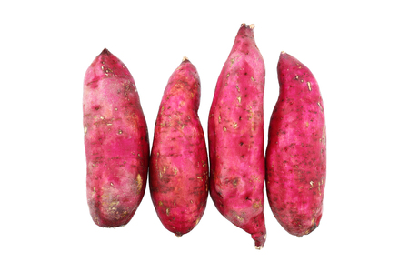 it is original sweet japanese potatoes isolated on white.