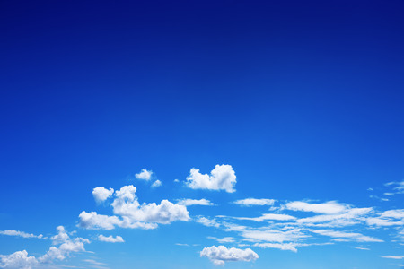 it is beautiful white clouds on blue sky for background and design. Reklamní fotografie