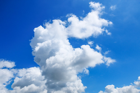 overcast: it is large white clouds on blue sky for background and design. Stock Photo
