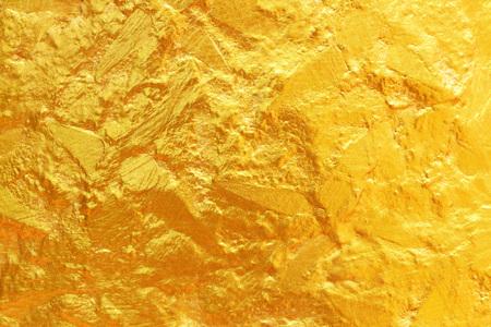 Het is gouden textuur voor achtergrond en ontwerp.